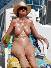 Titted Granny sunbathing on vacation