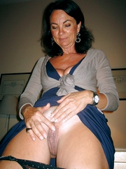 Naked milf rubs her wet clit and..