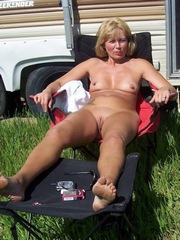 Sexy naked milf sunbathing near the..