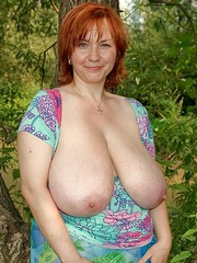 Cheerful mature shows her huge dangling..