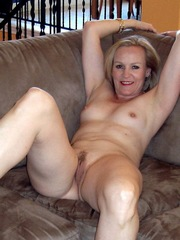 Well preserved granny naked on a couch