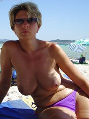 Busty matures nude on the beach