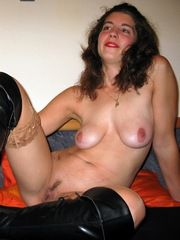 Naked brunette in big black boots